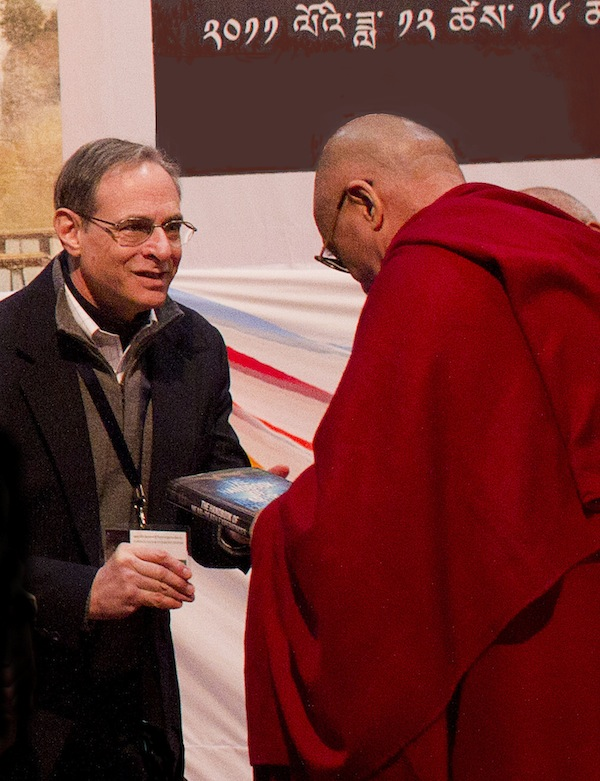 Bruce Greyson presents book to Dalai Lama